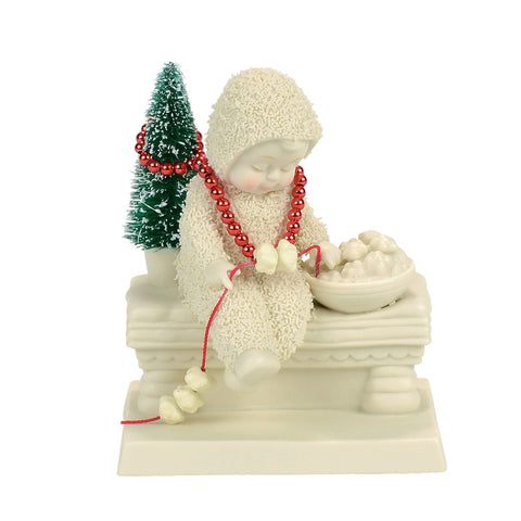 Dressing the Tree Figurine