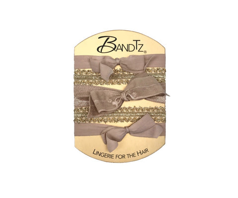 Bandtz Monroe Set in Gold. Five Gold hair elastics.