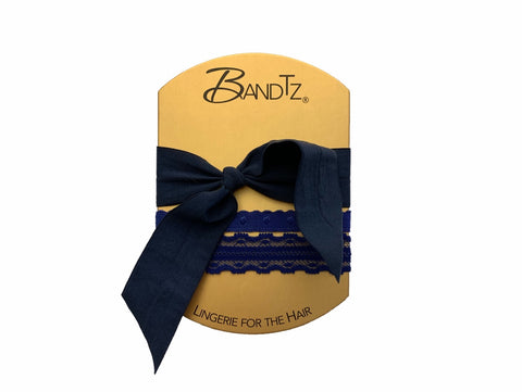 Dita Set in Blue. Three Bandtz bands. Navy blue hair accessories. One lace elastic hair band, one demi-dot hair tie, and one matte long hair hair elastic.