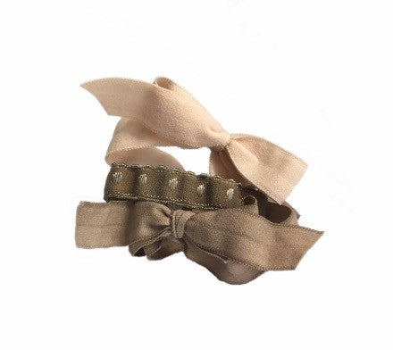 Fawn Set by Bandtz in pile. Five Bandtz hair elastics in nude, khaki, cargo green color combination. Three matte hair bows, two demi dot hair bands. Hair accessory with strong hold. Best hair ties for thick hair and curly hair.
