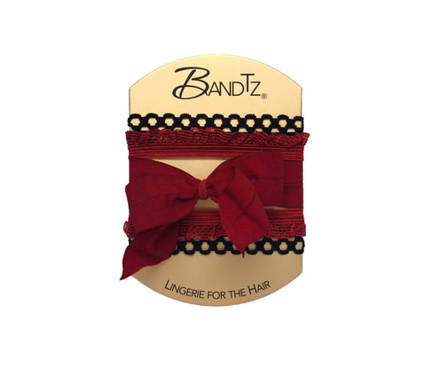 Frida Set by Bandtz. Five hair ties. One wide matte bow in Red, two black picot hair bands, and two red frill hair bands. Elastic hair accessories. Handmade in NYC