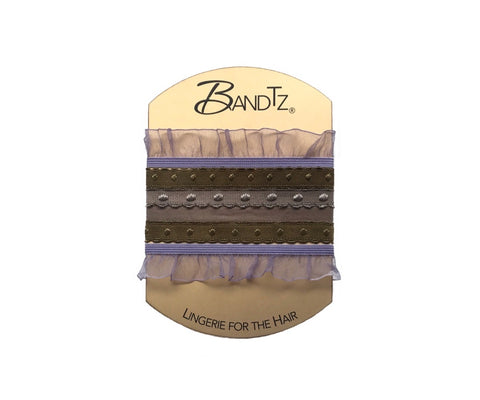 Grace Set by Bandtz. Five Bandtz hair bands in beige and lavender. Two elastic organza ruffle hair bands, and three dotted elastic bands. Hair ties for thick and thin hair.