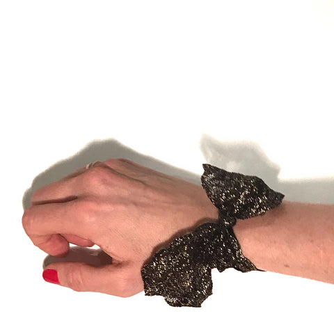Black Luxe Lace Tail Band on wrist. Bandtz hair tie handmade from high end elastic lace trim. Hair tie bracelet. Hair tie jewelry for women.