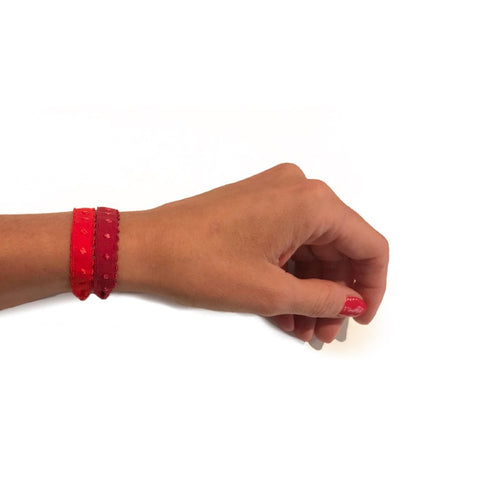 Two demi-dot Bandtz hair bands in red shown on wrist. Hair bands from the Bandtz Nina Set.  Chic hair tie bracelet.
