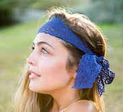Brunette wearing a Blue Luxe Lace Bow Headband from Bandtz. Elastic lace lingerie trim. Handmade.