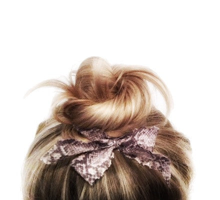 Hair bow in top knot. Bandtz snake print hair bow from Harlow Set. Sexy hair elastic.