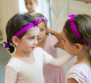 Two girls with matching headbands. Satin Bow Headbands by Bandtz