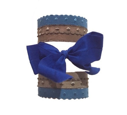 Bandtz Marlene Set in Blue. Five handmade Bandtz hair ties.  Four dotted hairbands, one wide matte hair bow. Microfiber hair ties, easy on hair, prevents knots and tangles, and no crease! Doubles as bracelet when on the wrist.