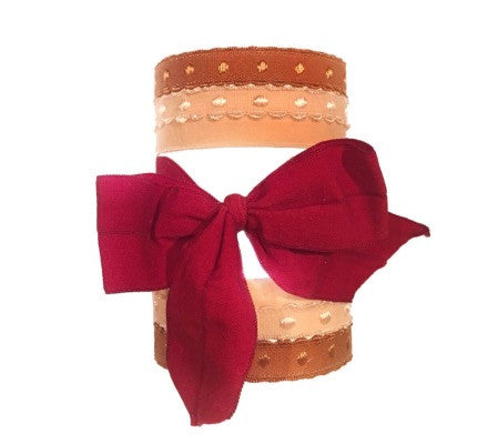 Bandtz Marlene Set in Red. Five handmade Bandtz hair ties.  Four dotted hairbands, one wide matte hair bow. Microfiber hair ties, easy on hair, prevents knots and tangles, and no crease! Doubles as bracelet when on the wrist