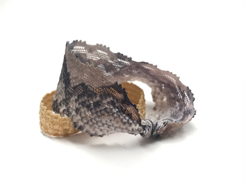 Hayworth - Bandtz. Closeup on snake print elastic lace hair tie.