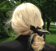 Blond wearing Bandtz lace hair bow.