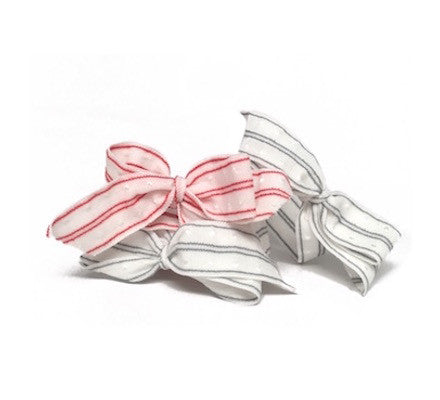 Bandtz Swiss Dot Bow in White Red Blue. Elastic hair bows with blue or red stripes.