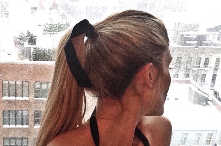Long tail hair band by Bandtz. Black satin elastic hair band with long tail. Beauty trend and fashion favorite.