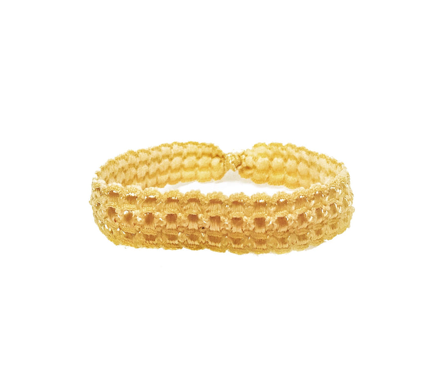Gold embossed hair band by Bandtz. One of two featured in the Bandtz Gabor Set.