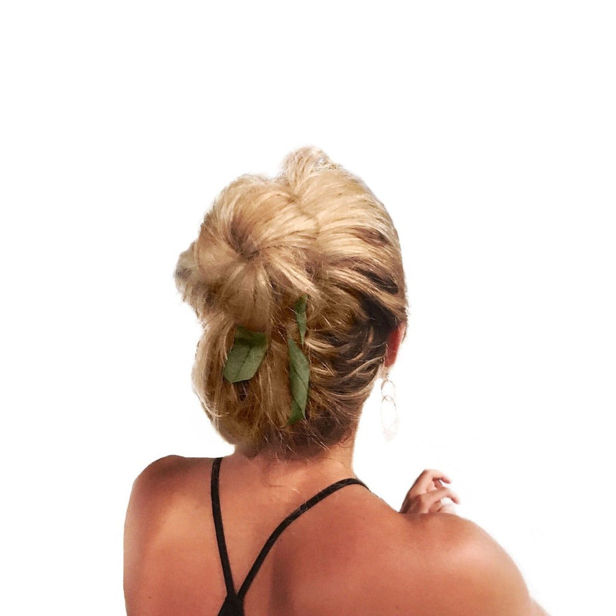 Blonde wearing Bandtz Wide Tail Hair Ribbon in Olive.