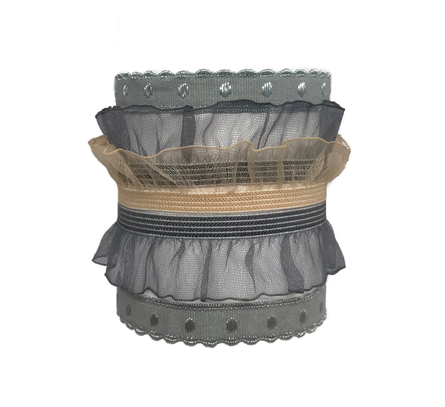 Coco Set in Grey. Five Bandtz hair bands. Elastic organza ruffle, scalloped elastic with shimmer dots. Great for delicate hair. Sexy hair ties that look like a garter on the wrist.