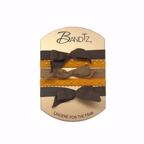 Vivien Set in Brown. Five Bandtz hair bands in three shades of brown. Three stretch hair bows in browns, two dotted hair bands in yellow.