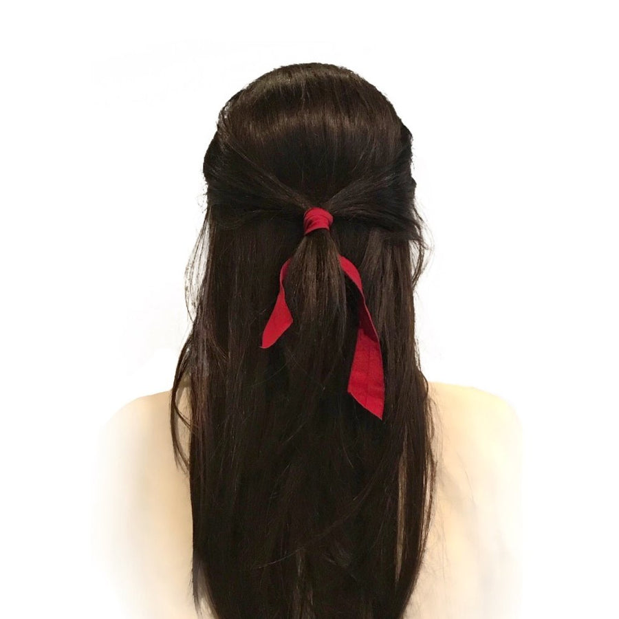Brunette wearing Bandtz Matte Wide Tail in Red.