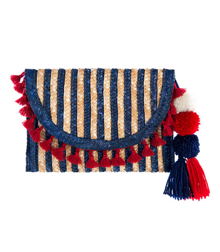 Stripes clutch with pom poms