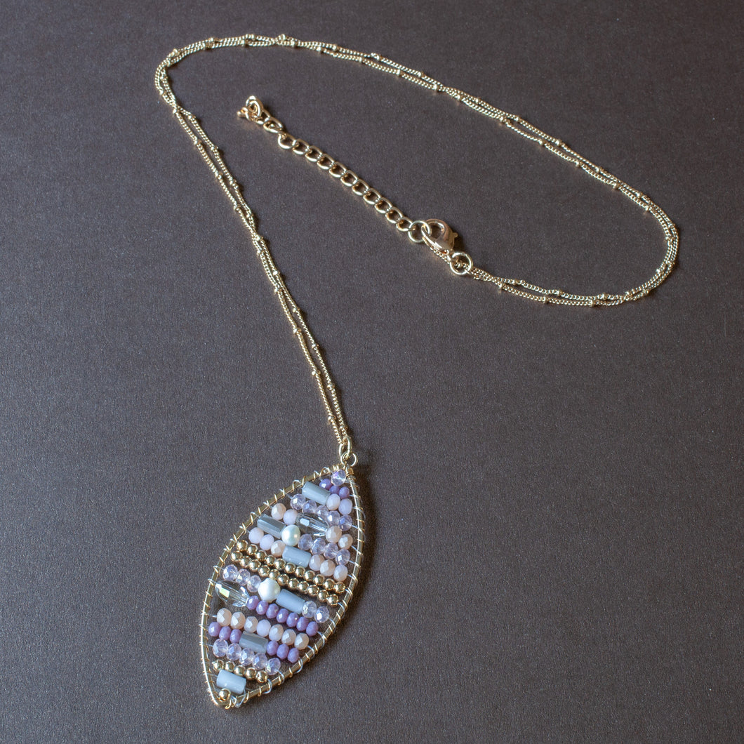 beaded oval pendant