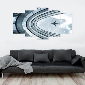 Airplane Flying Over Building 5 Piece Canvas Wall Art