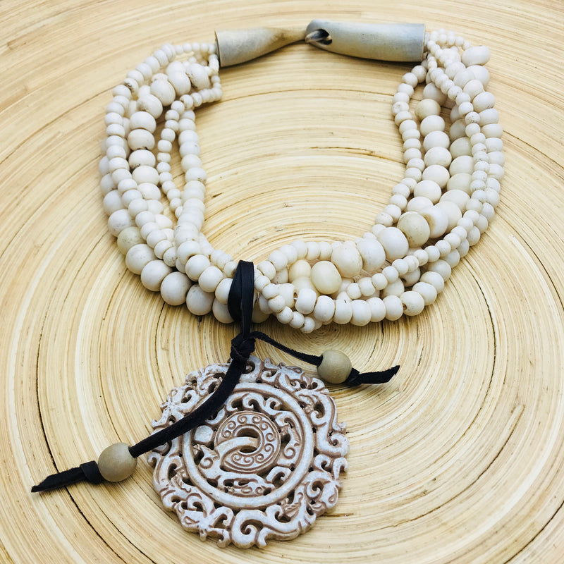 5 strand white wood with removable Carved Stone Pendant