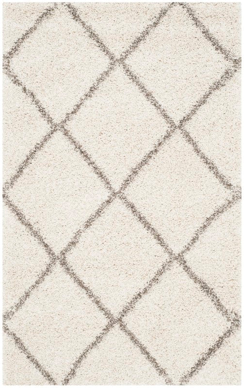 Duhon Ivory/Gray Shag Area Rug - @ARFurnitureMart