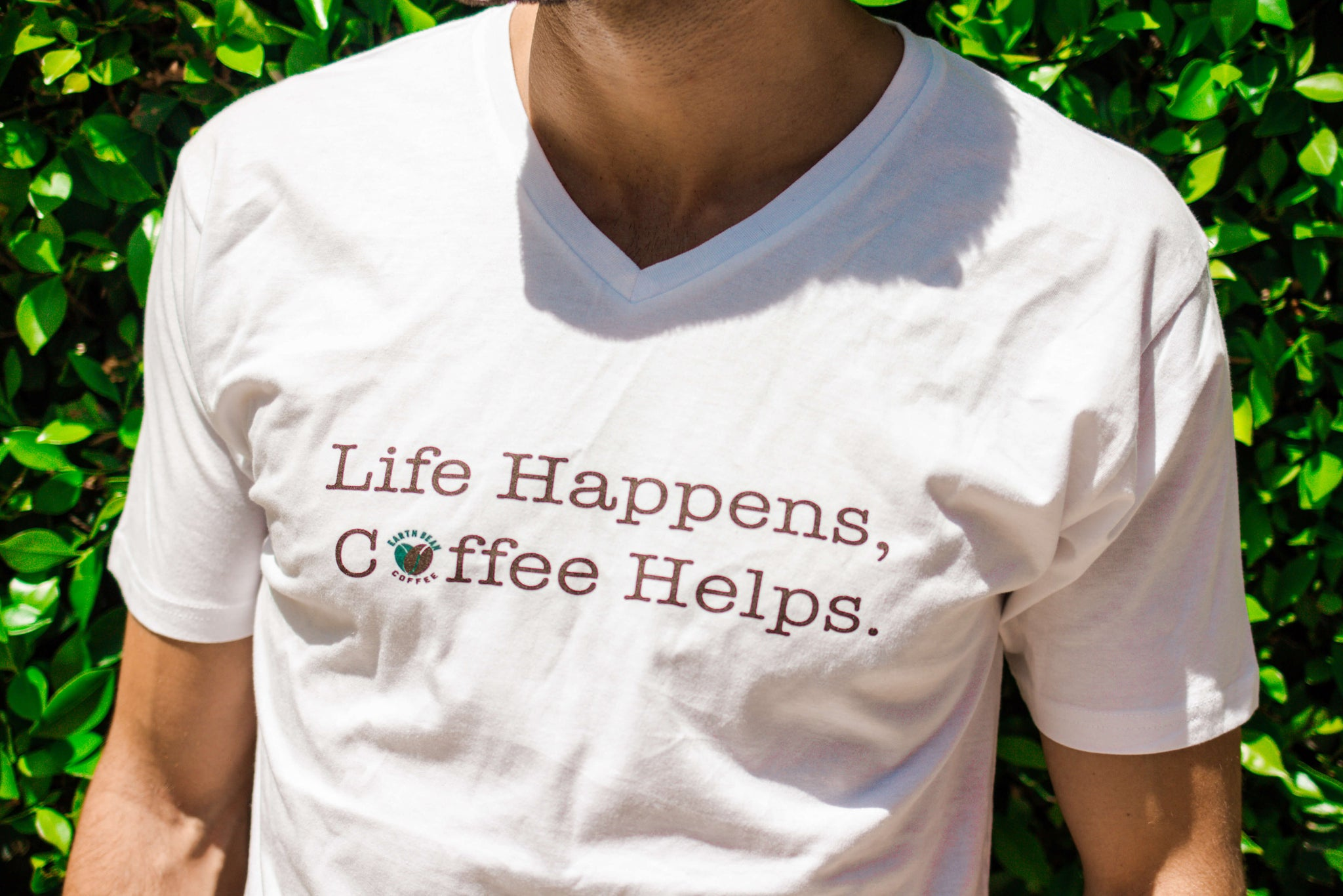 """Life Happens, Coffee Helps."" Unisex Tee"