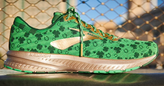 Brooks Shamrock Shoes 2019 Launch -  Green and gold never looked so fast. With plaid laces, pot o' gold eyelet accents, horseshoe, and a dash of four leaf clover, you've found yourself the luck of the Irish for this season's St. Patrick Day races. The Brooks Shamrock Launch 6's won't dissapoint, whether you are on the run, walk or rocking them at your annual St Patrick's Day Party.