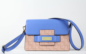 Signature coated canvas with refined calf leather details. 9.8 x 9.8x 5.1in Fabric lining Color: Marina Blue Inside multifunction and zip pockets Drawstring closure Adjustable strap for shoulder or crossbody wear Imported Style # EM002