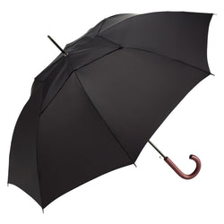 traditional black stick umbrella with a vented double canopy and curved wood handle, on its side at a 45 degree angle