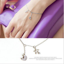 SHNCA Silver bracelet with moon and star charms