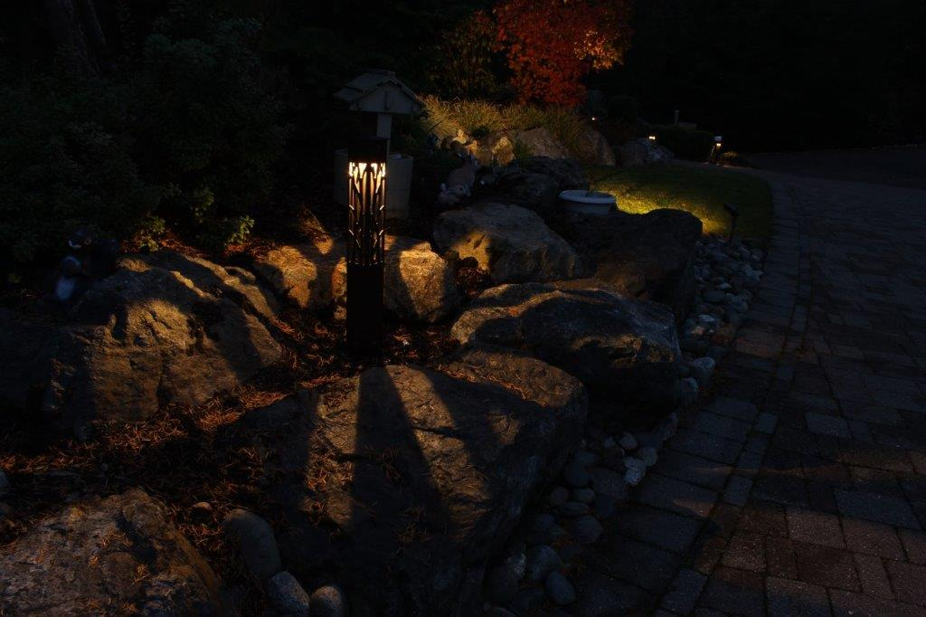 Garden rocks lit by patterned landscape light