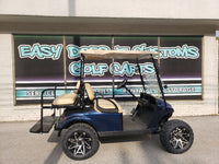 Gas EZGO TXT Lifted Golf Cart - Blue