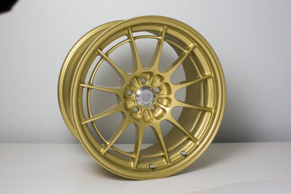 Enkei NT03+M 18x9.5 5x100 40mm Offset Gold Wheel - Dialed In Racing