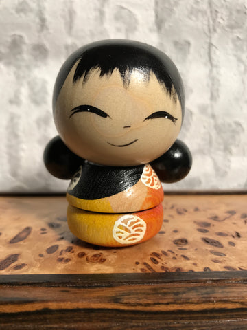 Kokeshi Doll - Orange Shirt