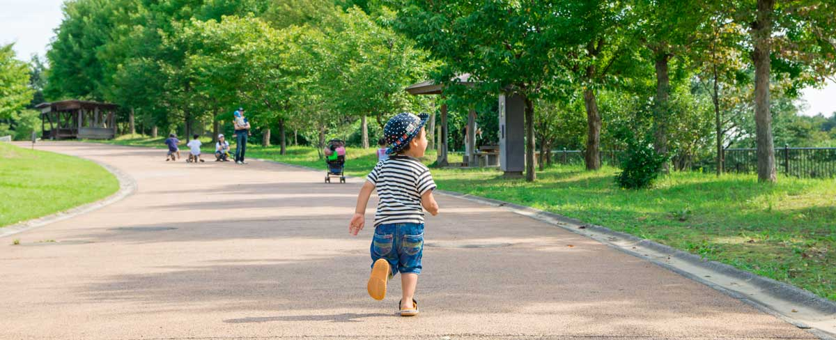 Toddler in park on excursion - Butler Creative Childcare Resources