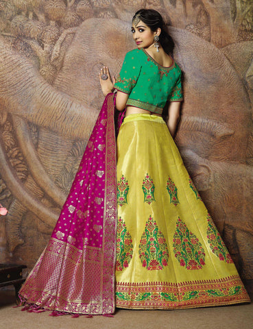 Yellow Silk Party Wear Lehenga With Green Choli