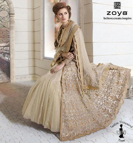 Heavy embroidered beige color designer semi stitched suits