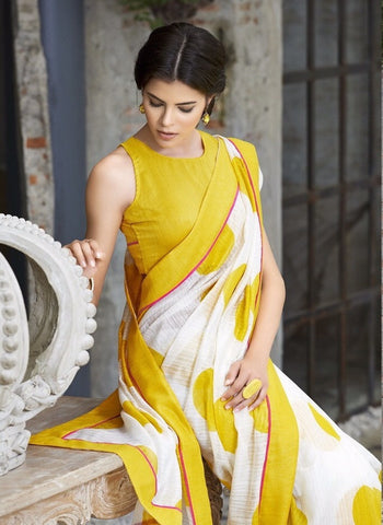 Yellow Lening Saree with silk blouse