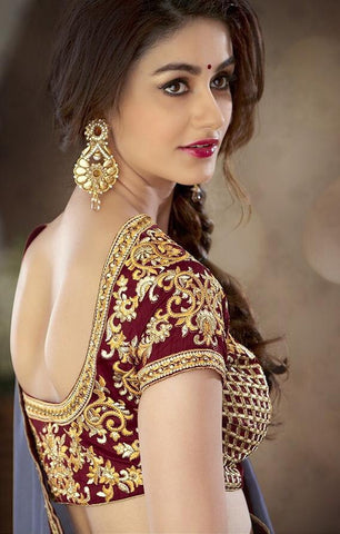 Shaded grey satin saree with contrasting maroon blouse