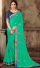 Green Georgette Party Wear Saree With Blue Blouse