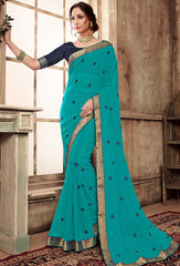 Turquoise Blue Georgette Party Wear Saree With Navy Blue Blouse