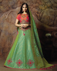 Green Silk Party Wear Lehenga With Orange Choli