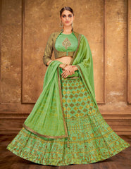 Green Weaved Silk Party Wear Lehenga With Green Choli And Green Dupatta