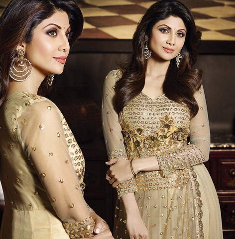 Golden anarkali salwar suits with net embroidery and stone work