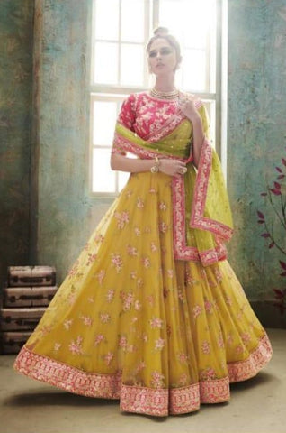 Yellow Net Party Wear Lehenga With Green Dupatta
