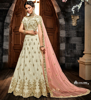 Off White Silk Party Wear Lehenga With Pink Dupatta