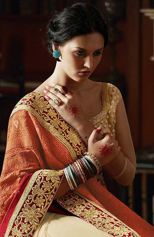 Orange shaded and beige saree with heavy embroidery