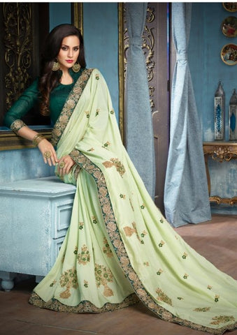 Light Green Silk Party Wear Saree With Dark Green Blouse